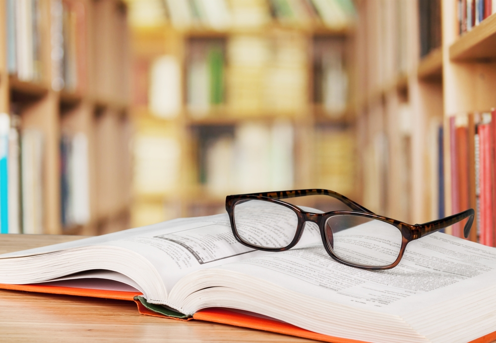 Glasses and Textbook